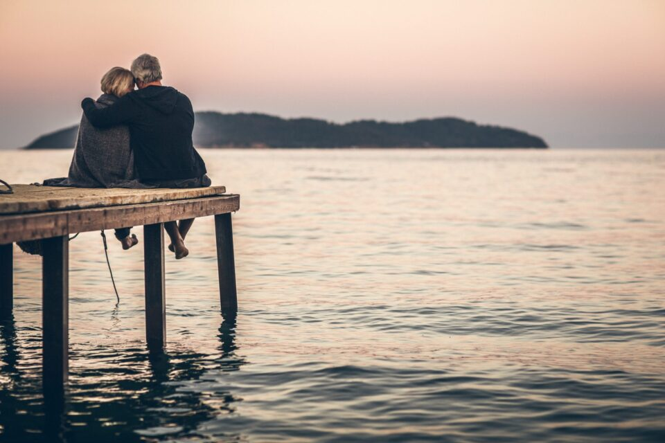 couple-sitting-on-dock
